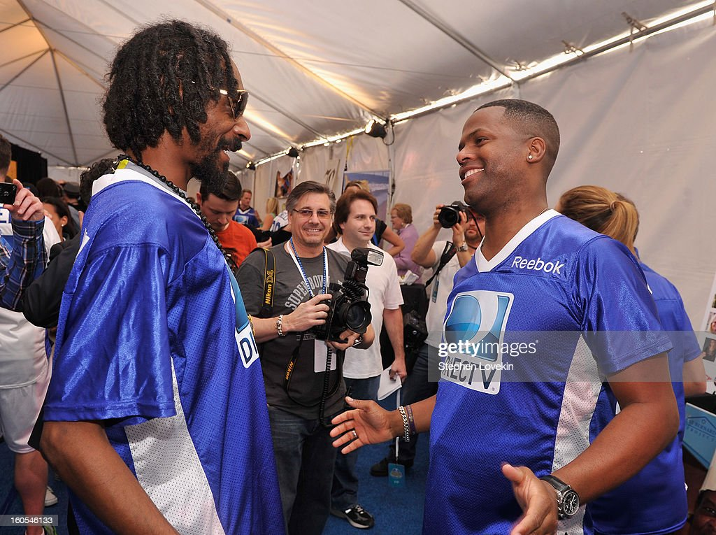Snoop Dogg and A. J. Calloway attends GBK and DirecTV Celebrity Beach Bowl Thank You Lounge at DTV SuperFan Stadium at Mardi Gras World on February 2, 2013 in New Orleans, Louisiana.