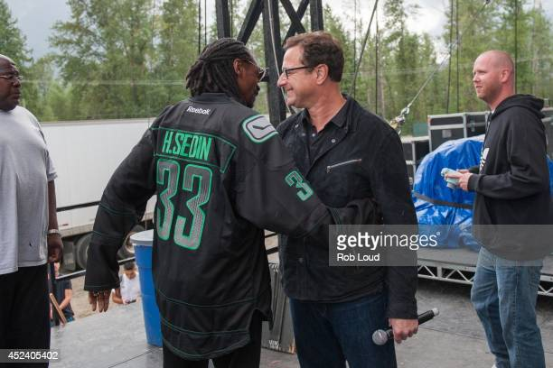 Snoop Dogg and Bob Saget talk backstage at the Pemberton Music Festival on July 19 2014 in Pemberton Canada