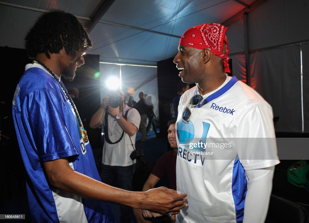 Snoop Dogg and Deion Sanders attend DIRECTV'S 7th annual celebrity Beach Bowl at DTV SuperFan Stadium at Mardi Gras World on February 2, 2013 in New Orleans, Louisiana.