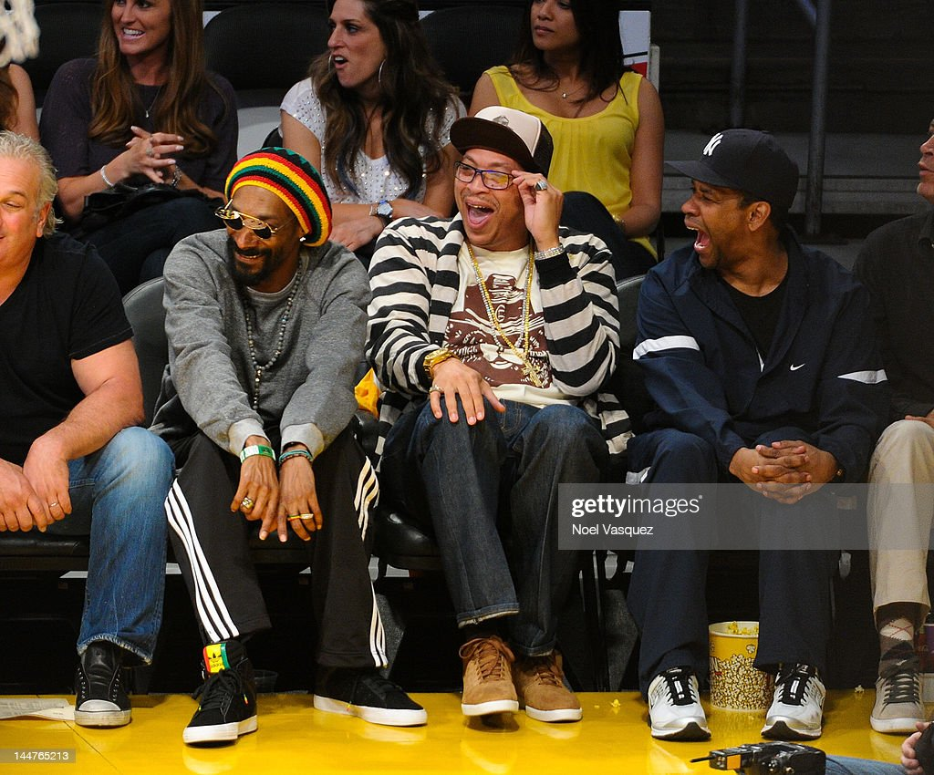 Snoop Dogg (L) and Denzel Washington (R) attend the Los Angeles Lakers and Denver Nuggets game 7 of the Western Conference Quarterfinals in the 2012 NBA Playoffs on May 18, 2012 in Los Angeles, California.