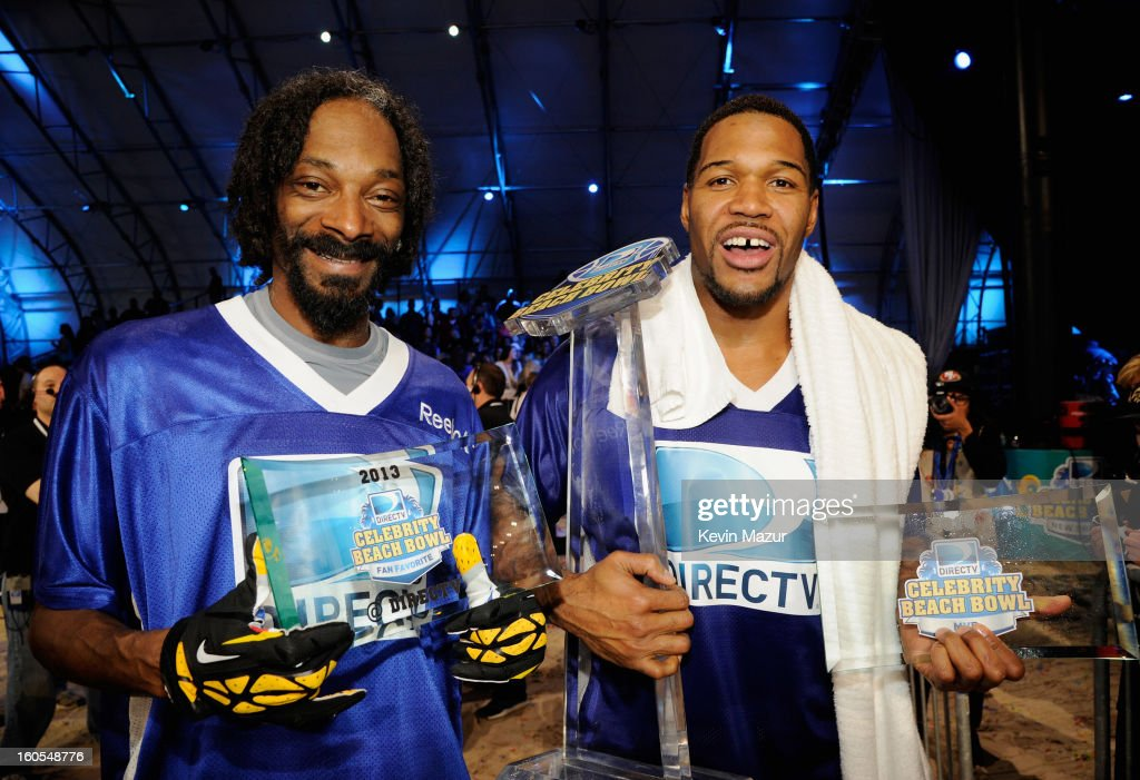 Snoop Dogg (L) and former professional football player Michael Strahan attend DIRECTV'S 7th annual celebrity Beach Bowl at DTV SuperFan Stadium at Mardi Gras World on February 2, 2013 in New Orleans, Louisiana.