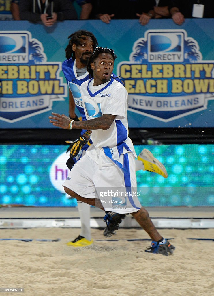 <a gi-track='captionPersonalityLinkClicked' href=/galleries/search?phrase=Snoop+Dogg&family=editorial&specificpeople=175943 ng-click='$event.stopPropagation()'>Snoop Dogg</a> and Lil Wayne attend DIRECTV'S 7th annual celebrity Beach Bowl at DTV SuperFan Stadium at Mardi Gras World on February 2, 2013 in New Orleans, Louisiana.
