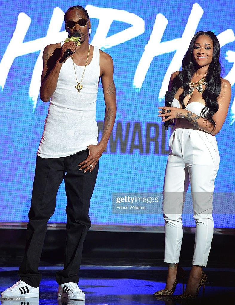 Snoop Dogg and Mimi Faust onstage at the BET Hip Hop awards at Boisfeuillet Jones Atlanta Civic Center on September 20, 2014 in Atlanta, Georgia.
