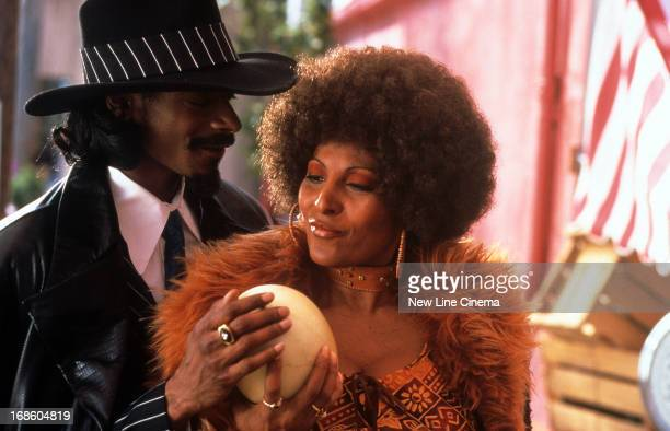 Snoop Dogg and Pam Grier feeling a melon in a scene from the film 'Bones' 2000