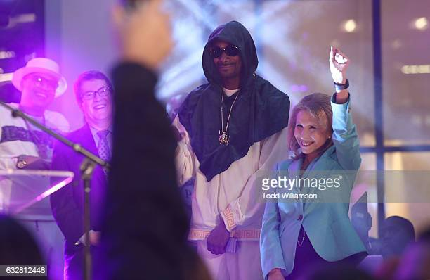 Snoop Dogg and Viacom ViceChairwoman Shari Redstone attend the Ribbon Cutting for the new Viacom Building on January 26 2017 in Los Angeles California