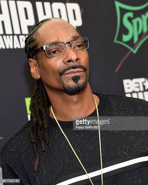 Snoop Dogg attends the BET Hip Hop Awards 2016 Green Carpet at Cobb Energy Performing Arts Center on September 17 2016 in Atlanta Georgia