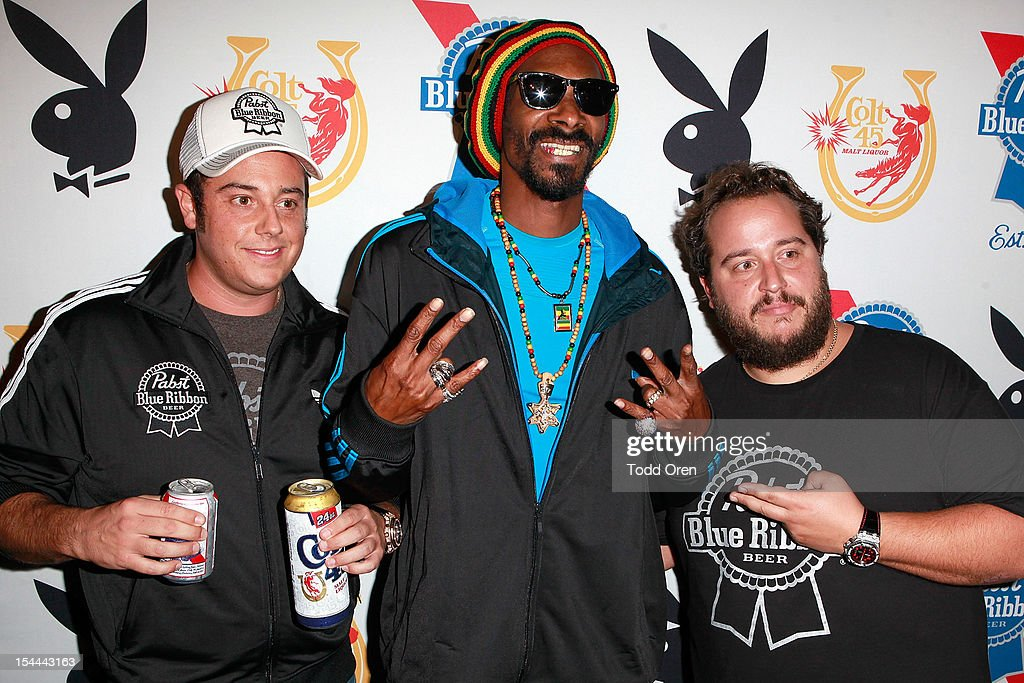 Snoop Dogg, Evan Metropoulos and Daren Metropoulos pose at the Snoop Dogg Presents: Colt 45 Works Every Time at The Playboy Mansion Party with Evan and Daren Metropulos on October 19, 2012 in Beverly Hills, California.