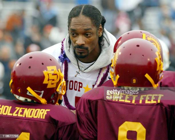 Snoop Dogg goes over a play with his team at the 2nd Annual Ricky Williams Pop Warner Celebrity Football Game with Snoop Dogg