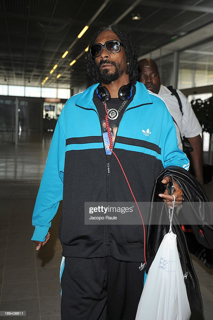 <a gi-track='captionPersonalityLinkClicked' href=/galleries/search?phrase=Snoop+Dogg&family=editorial&specificpeople=175943 ng-click='$event.stopPropagation()'>Snoop Dogg</a> is seen arriving at Nice airport during The 66th Annual Cannes Film Festival on May 24, 2013 in Nice, France.