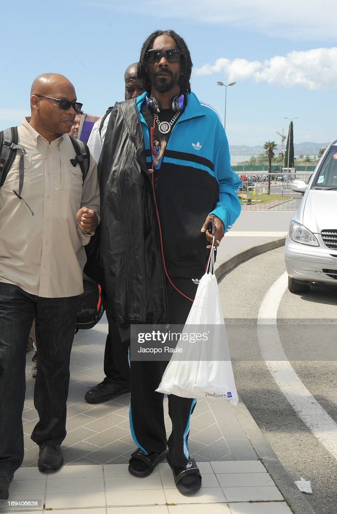 <a gi-track='captionPersonalityLinkClicked' href=/galleries/search?phrase=Snoop+Dogg&family=editorial&specificpeople=175943 ng-click='$event.stopPropagation()'>Snoop Dogg</a> (C) is seen arriving at Nice airport during The 66th Annual Cannes Film Festival on May 24, 2013 in Nice, France.