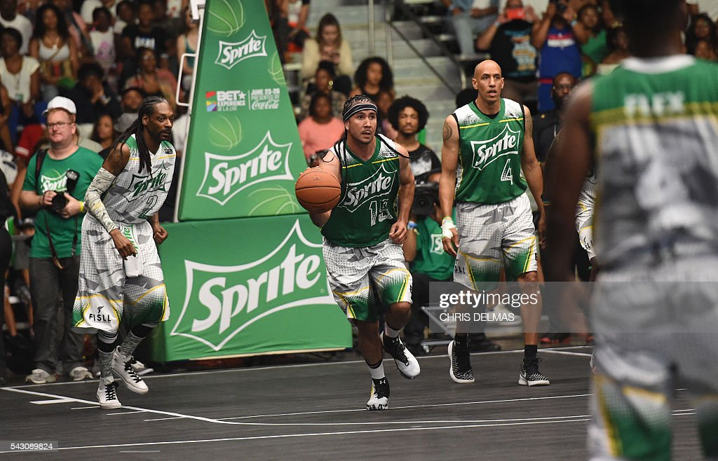 Snoop Dogg, Kenny Dobbs and Doug Christie participate in the Celebrity Basketball Game at BET Experience at the Convention Center in Los Angeles, on June 25, 2016. / AFP / CHRIS