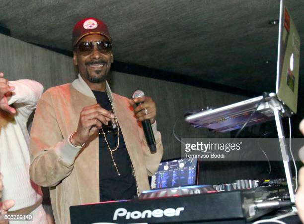 Snoop Dogg performs at Calvin Harris' album launch party at a private residence on June 29 2017 in Los Angeles California
