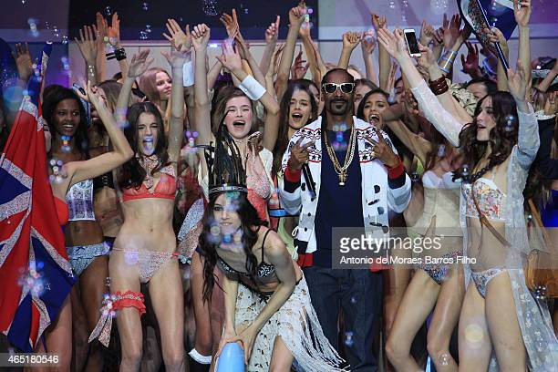 Snoop Dogg performs during the ETAM show as part of the Paris Fashion Week Womenswear Fall/Winter 2015/2016 on March 3 2015 in Paris France