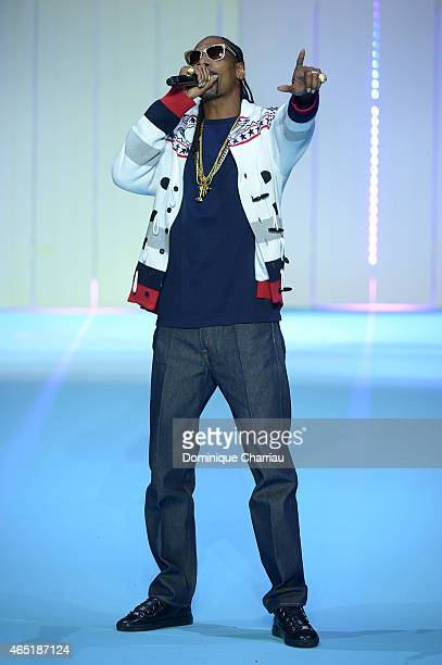 Snoop Dogg performs on the runway during the ETAM show finale as part of the Paris Fashion Week Womenswear Fall/Winter 2015/2016 on March 3 2015 in...