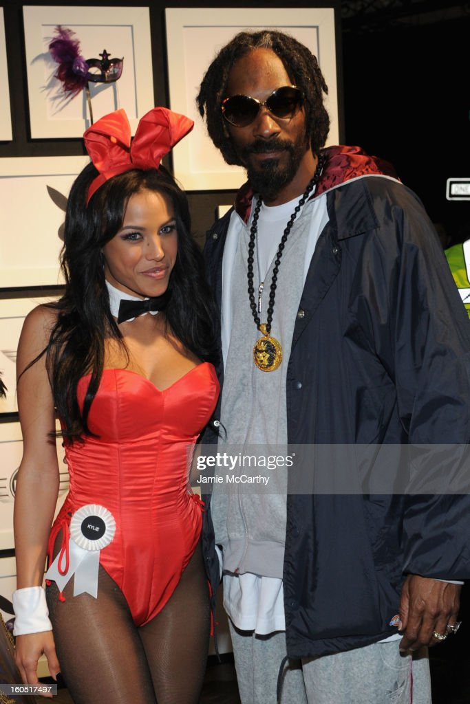 Snoop Dogg (R) poses with Playmate Kylie Johnson at The Playboy Party Presented by Crown Royal on February 1, 2013 in New Orleans, Louisiana.