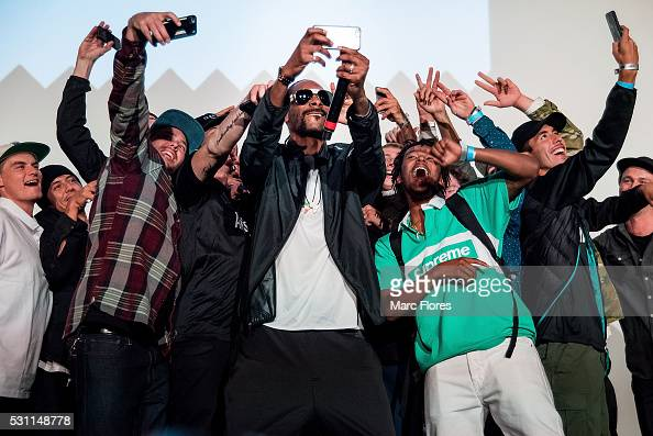 Snoop Dogg takes a selfie with fans at the premiere of Adidas' 'Away Days' at The Orpheum Theatre on May 12 2016 in Los Angeles California