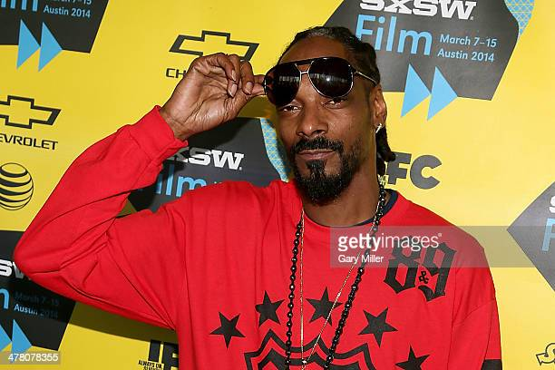 Snoop Dogg walks the red carpet for the premiere of 'Take Me To The River' at the Topfer Thater during South By Southwest on March 11 2014 in Austin...