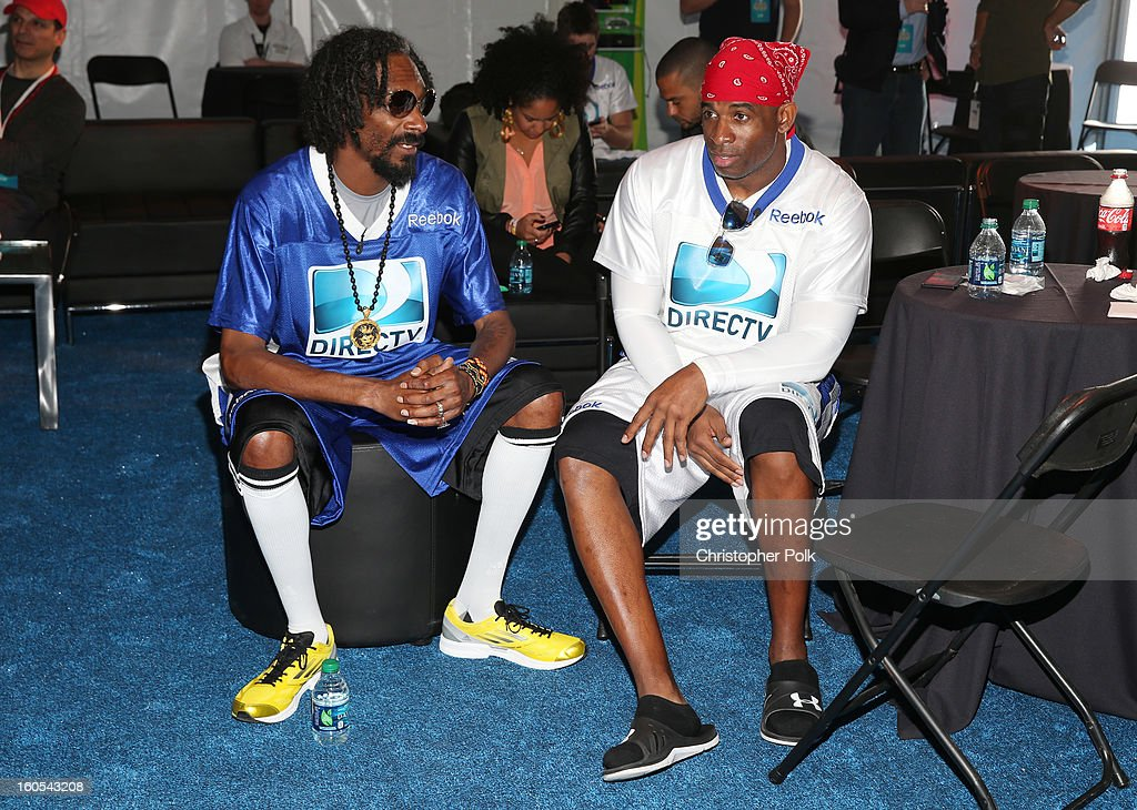 Snoop Lion (L) and Deion Sanders attend DIRECTV'S Seventh Annual Celebrity Beach Bowl at DTV SuperFan Stadium at Mardi Gras World on February 2, 2013 in New Orleans, Louisiana.