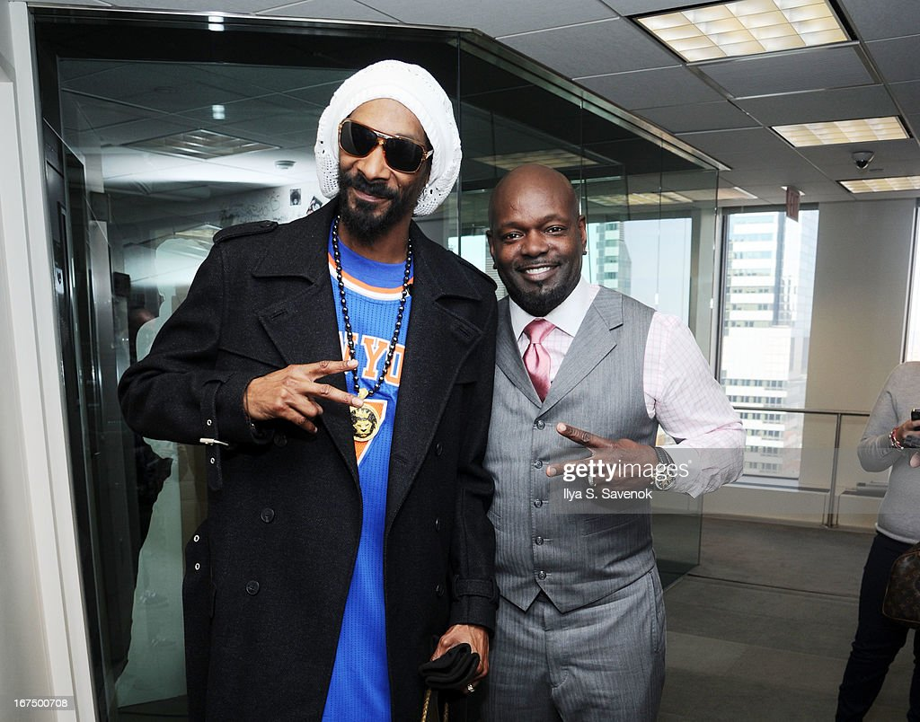 Snoop Lion and Emmit Smith visit the SiriusXM Studios on April 25, 2013 in New York City.