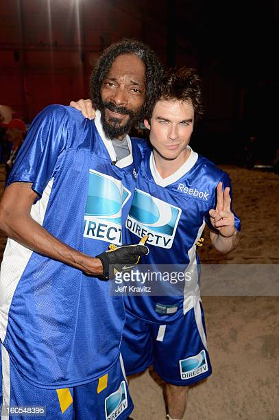 Snoop Lion and Ian Somerhalder attend DIRECTV'S 7th Annual Celebrity Beach Bowl at DTV SuperFan Stadium at Mardi Gras World on February 2 2013 in New...