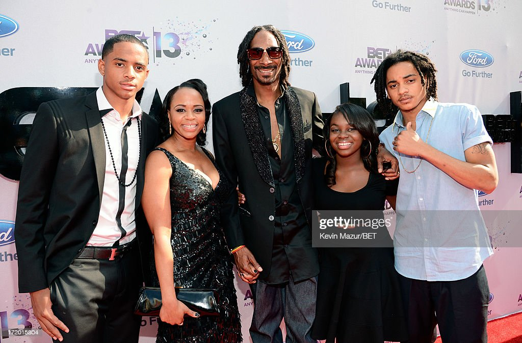 Snoop Lion (C), formerly Snoop Dog, arrives with his family at the Ford Red Carpet at the 2013 BET Awards at Nokia Theatre L.A. Live on June 30, 2013 in Los Angeles, California.