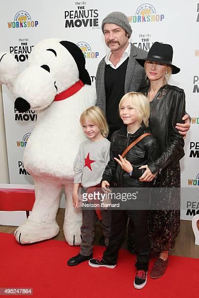 Snoopy Liev Schreiber Naomi Watts Samuel Kai Schreiber and Alexander Pete Schreiber attend the Peanuts movie and BuildABear Workshop special...