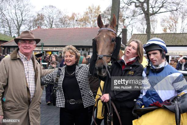 Snoopy Loopy and jockey Seamus Durack with some of owners after winning the BetFair Steeplechase during The Northwest Masters Betfair Chase at...