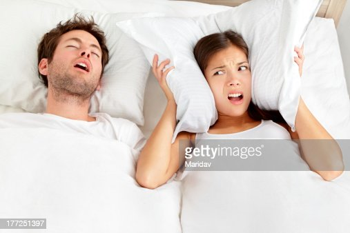 Snoring man - couple in bed : Stock Photo