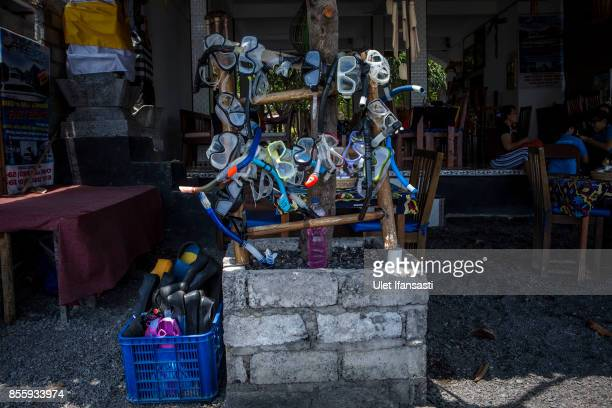 KARANGASEM BALI INDONESIA SEPTEMBER 30 Snorkel equipments is seen at Amed beach as emptied of tourists on September 30 2017 in Karangasem regency...