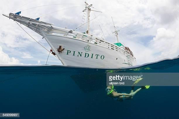 Snorkeler and Liveaboard Raja Ampat West Papua Indonesia
