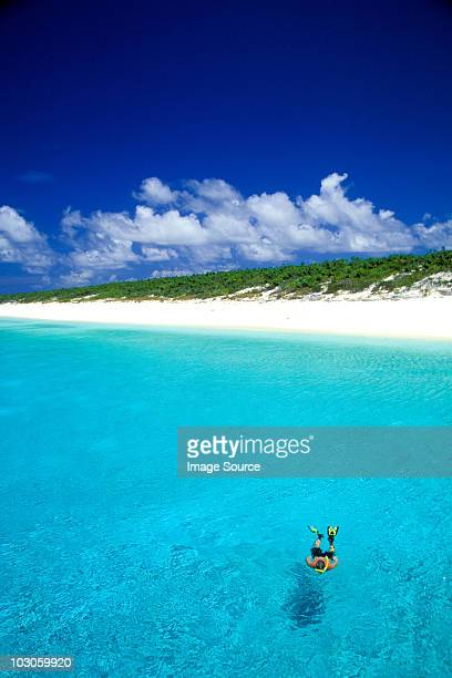 Snorkeler by remote island.