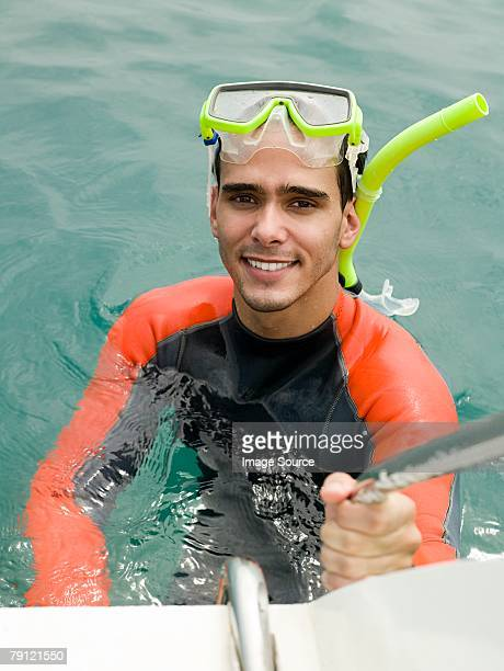 Snorkeler getting on boat