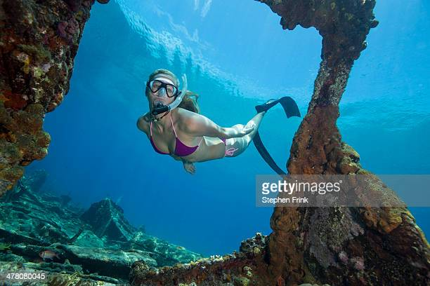 Snorkeler on shipwreck