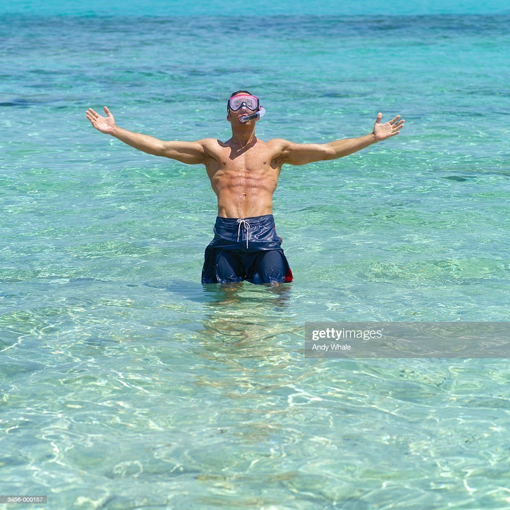 Snorkeler Standing in Ocean : Stock Photo