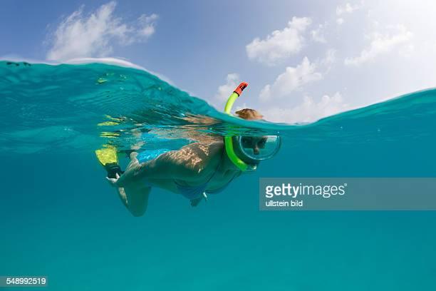 Snorkeling in turquoise Lagoon Marshall Islands Bikini Atoll Micronesia Pacific Ocean