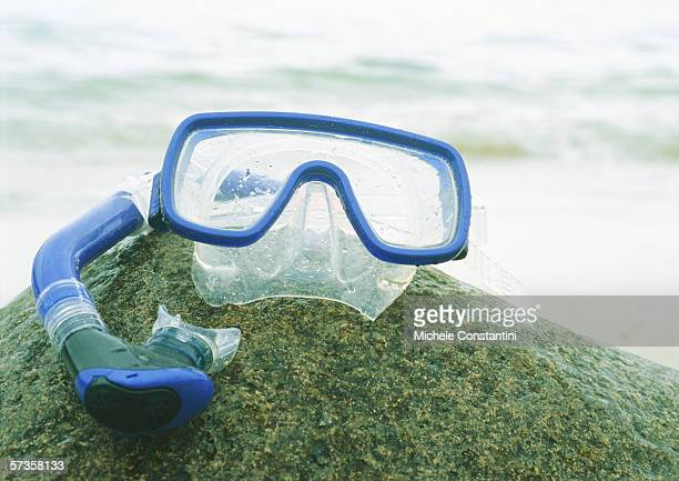 Snorkeling mask and snorkel on rock