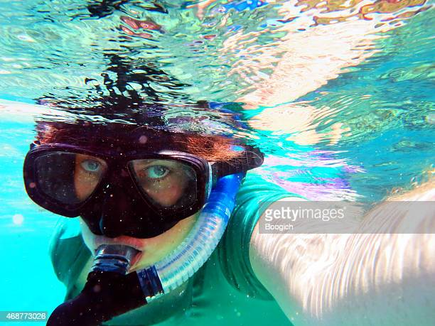 Snorkeling Woman Takes Underwater Selfie on Bali Indonesia Adventure Travel