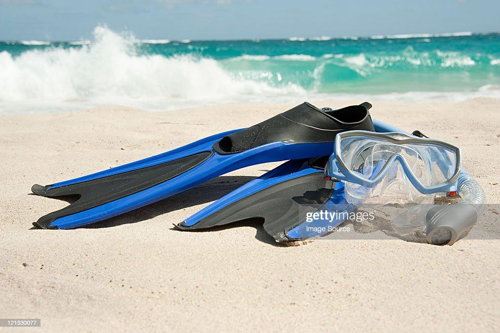 Snorkelling equipment at water's edge, Mustique, Grenadine Islands