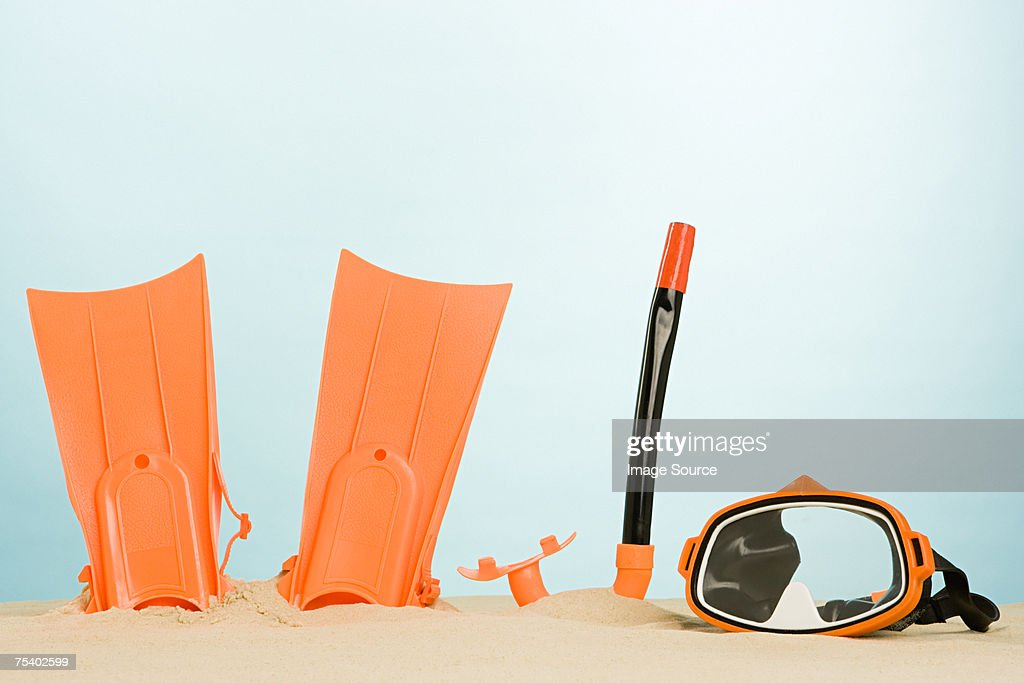 Snorkelling equipment in sand