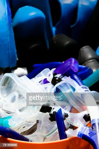 Snorkels and scuba masks in a bucket : Stock Photo