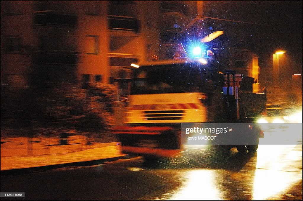 Snow and cold weather in eastern France, On January 26, 2006-Erstein, salting truck working at night on roads in the Bas Rhin region.