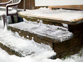 Wooden steps with snow and ice removed, outdoor closeup