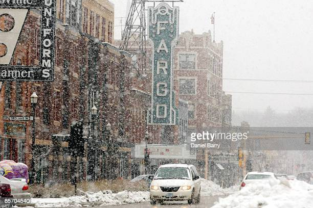 Snow begins to fall March 302009 in downtown Fargo North Dakota Fargo and the surrounding area are expecting a storm Monday that could bring up to 14...