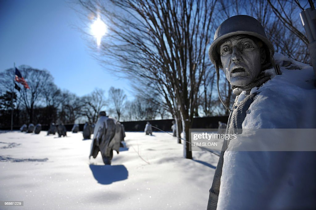 Snow blankets the 19 stainless steel statues of the Korean War Veterans Memorial on the National Mall on February 8 2010 as the District of Columbia...