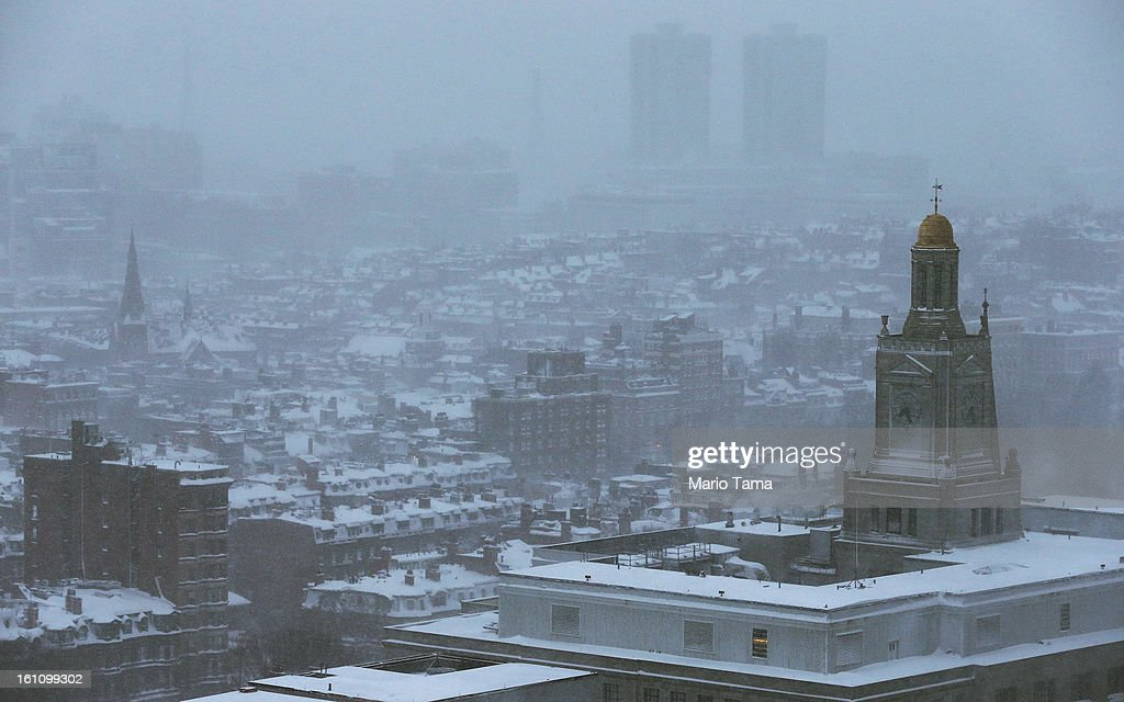 Snow blankets the city during a lingering blizzard on February 9, 2013 in Boston, Massachusetts. The powerful storm has knocked out power to 650,000 and dumped more than two feet of snow in parts of New England.