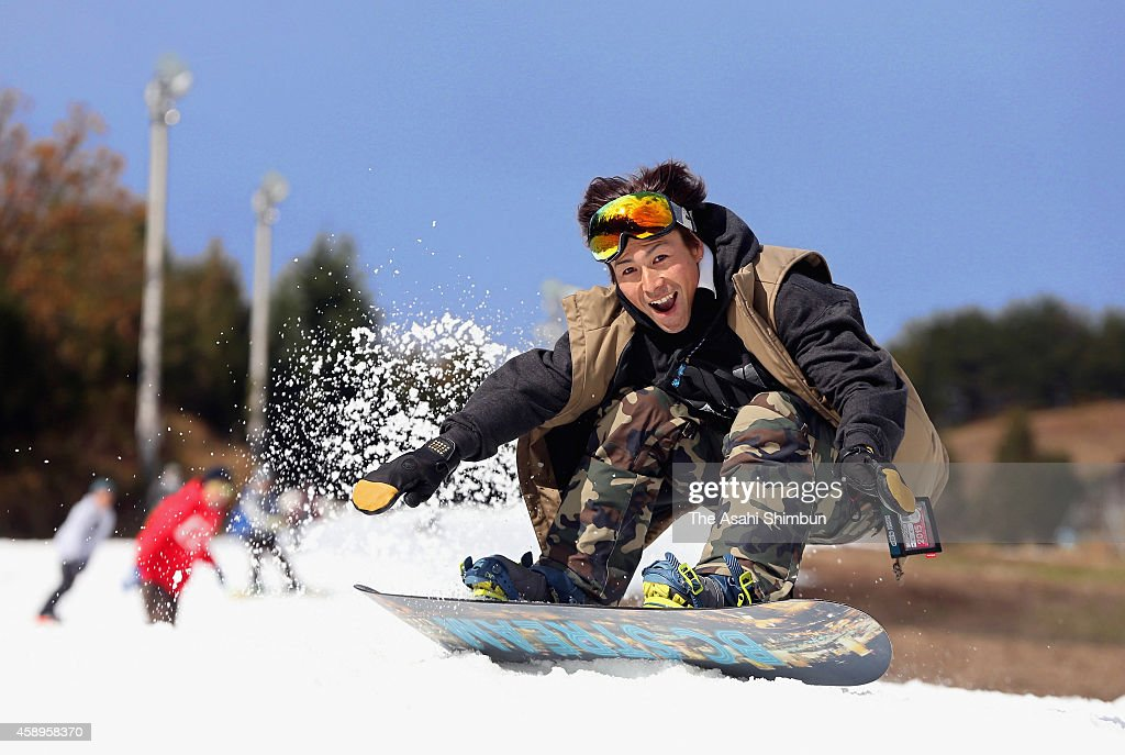 Snow boarders enjoy their first ride of the season as an artificial snow ski resort Up Kannabe opens on November 14, 2014 in Toyooka, Hyogo, Japan.