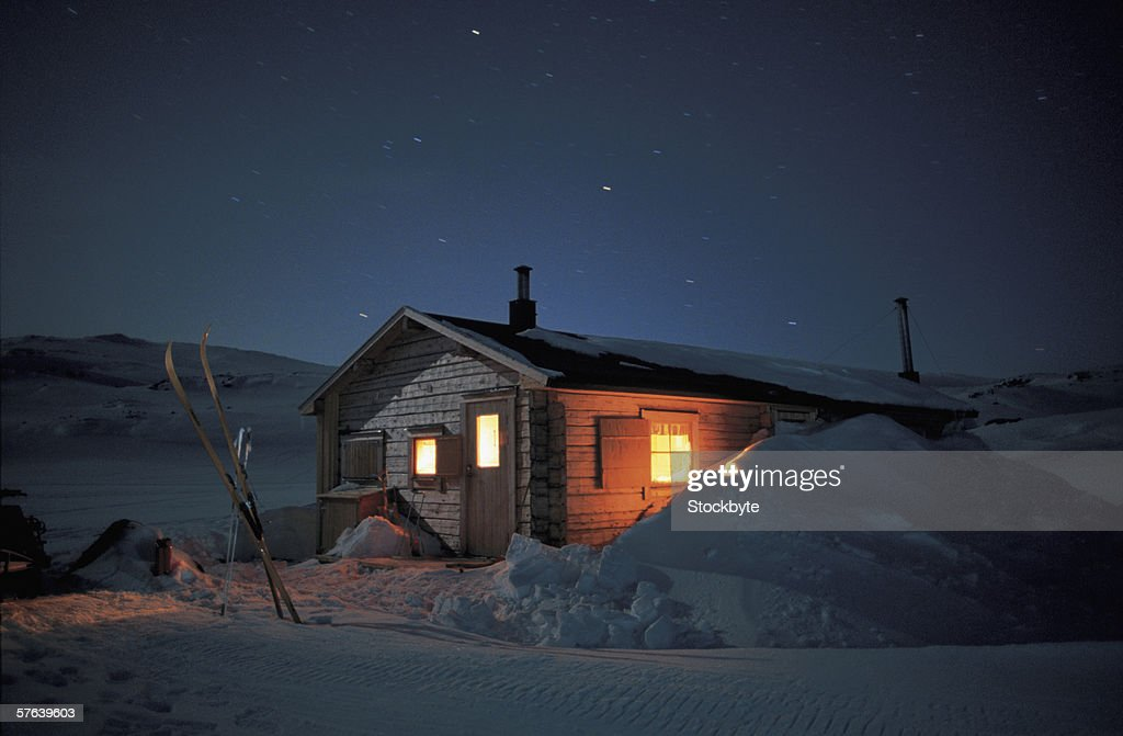 snow cabin at night