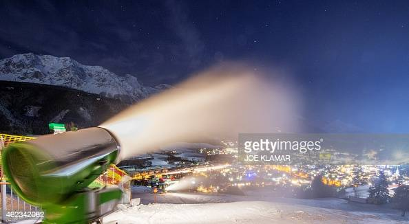 A snow cannon blows artificial snow on a tourist course on the eve the men's night slalom of the FIS Alpine Skiing World Cup in Rohrmoos near...