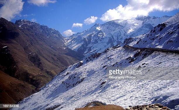 Snow capped mountain peaks in the Jebel Toubkal range Atlas mountains near Imlil Morocco