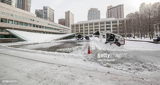 Snow cleaning in Manhattan around the Lincoln Center under snowstorm